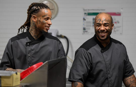Darius Staten, left, and Ryan Hicks share a humorous moment working the kitchen at Gatrick's restaurant Tuesday, June 4, 2019.