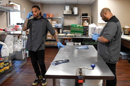 Darius Staten, left, Ryan Hicks on break in the kitchen at Gatrick's Tuesday, June 11, 2019.