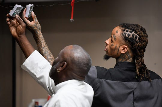 Gatrick's owner Gary Boyd and Darius Staten set digital timers for steaks cooking on the grill. For about four years, Boyd has been mentoring young men who have been in trouble with the law, helping them develop skills and a recommendation so they can get a good restaurant job as an assistant chef Tuesday, June 4, 2019.