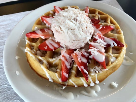 Sweety's Red & White Wonder Waffle features fresh strawberries, coconut, strawberry ice cream and white-chocolate sauce.