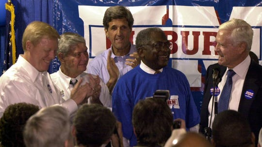 Democratic presidential candidates U.S. Rep. Dick Gephardt D-Mo, left; U.S. Sen. Bob Graham, D-Fla.; and U.S. Sen. John Kerry, D-Mass, applaud Rep. Jim Clyburn and Sen. Fritz Hollings at Clyburn's fish fry in a Columbia, SC, parking garage, May 2, 2003.