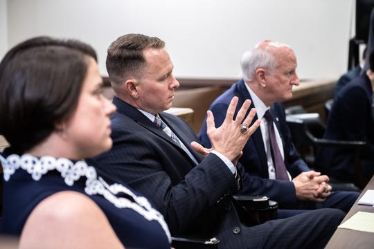 Will Lewis, suspended Greenville County Sheriff, sits with his wife, Amy Lewis, and attorney Rauch Wise at a motions hearing at the Laurens County Courthouse on Monday, June 17, 2019.