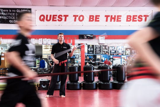 "Stephen ""Wonderboy"" Thompson, the head instructor at Upstate Karate in Simpsonville, leads a Beginner Weapons class Friday, June 14, 2019. Thompson, a welterweight UFC contender, has been training in martial arts since he was three years old."