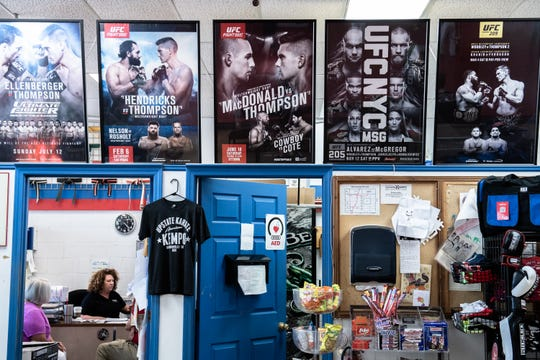 "UFC posters at Upstate Karate in Simpsonville where Stephen ""Wonderboy"" Thompson, a welterweight UFC contender, is the head instructor."