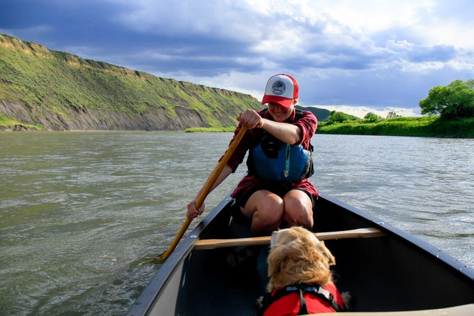 Owner Nicole Fugere and her sweet pup canoeing down the river