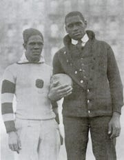 Fritz Pollard (left) poses with Paul Robeson, a singer, movie star, talented athlete and civil rights advocate.