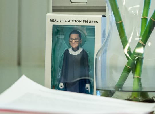 Aside from a Ruth Bader Ginsburg figurine, Many things still sit in boxes inside the office of Major Catherine Cummings, the first female major of the investigations division for the IMPD, on Friday, June 14, 2019.