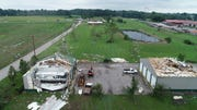 Buildings and debris are seen at State Road 46 and Flatwoods Road west of Ellettsville, Ind. Monday after one of six tornadoes touched down south of Indianapolis on Saturday evening. (Joe Tamborello and Amy Bartner/IndyStar drone photo)