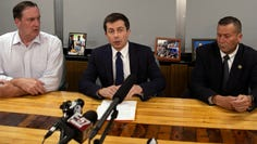 South Bend Mayor Pete Buttigieg, center, speaks during a news conference, Sunday, June 16, 2019, in South Bend, as South Bend Common Council President Tim Scott, left, and South Bend Police Chief Scott Ruszkowski, listen. Democratic presidential candidate Buttigieg changed his campaign schedule to return to South Bend for the news conference after authorities say a man died after a shooting involving a police officer.
