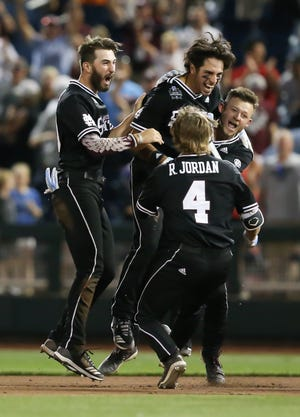 Mississippi State players celebrate after securing a bottom of the ninth walk-off victory over Auburn in the College World Series.