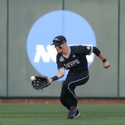 Mississippi State's Jake Mangum (15) fields a ball hit to center field. Mississippi State defeated Auburn in the opening round of the NCAA College World Series on Sunday, June 16.2019 at TD Ameritrade Park in Omaha.