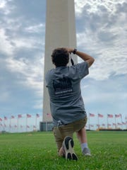 Benjamin Naylor, a Haywood County High School rising senior, photographs the Washington Monument during the Washington Youth Tour trip - an all-expense-paid trip he and others won from writing essays.