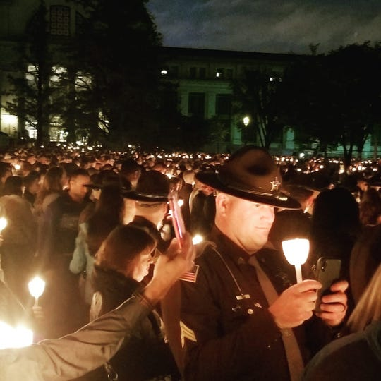 Law enforcement officers pay tribute to fallen officers during a candlelight vigil at the National Mall in Washington, D.C., on May 13, 2019.