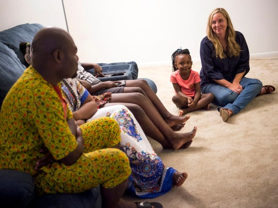 Volunteer Beth Chappelle, right, smiles as she talks with the Mukantu family at their apartment in Knoxville on Monday, June 10, 2019.