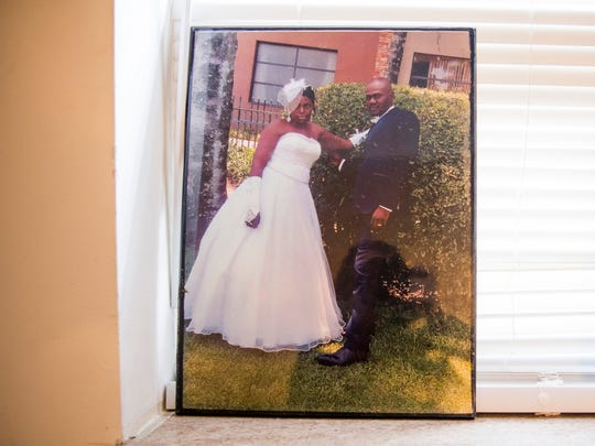 Wedding photos of Therese and Adolph Mukantu are displayed in their apartment in Knoxville on Monday, June 10, 2019. They've been married for 11 years.