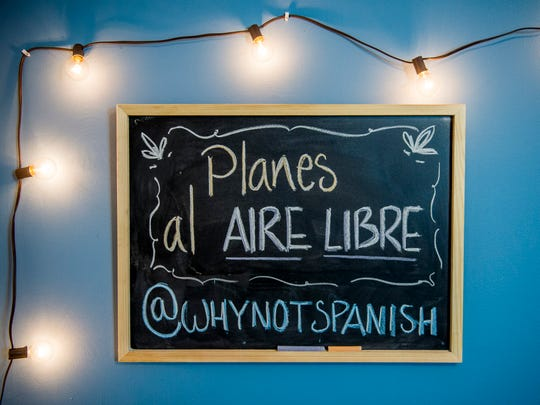 A chalkboard hangs in the studio where Maria Jaramillo and Cody Beeler film their popular WhyNotSpanish YouTube videos.