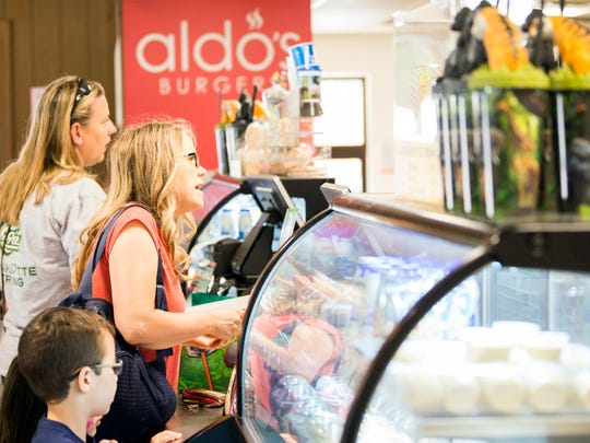 Zoo Knoxville guests order at Aldo's Grill on Thursday, June 13, 2019.