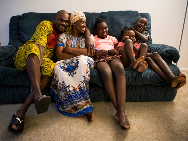 Adolph Mukantu, left, and Therese Mukantu, second from left, are photographed with their two children Priscilla, center, and Plamedi, right, as well as their niece Hosmah, second from right, at their apartment in Knoxville on Monday, June 10, 2019.