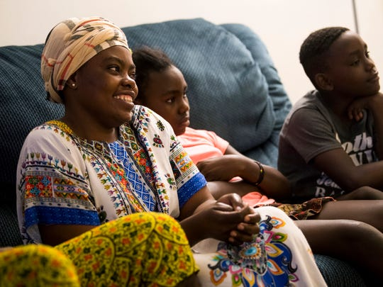 Therese Mukantu, left, talks about moving to Knoxville at the family's apartment Monday, June 10, 2019. The Mukantus moved to Knoxville three months ago from Uganda, where they'd been living for seven years.