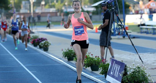 Brienne Trumpower, 14, of Mansfield wins the junior high one mile run at the New Balance Nationals in Greensboro, North Carolina.
