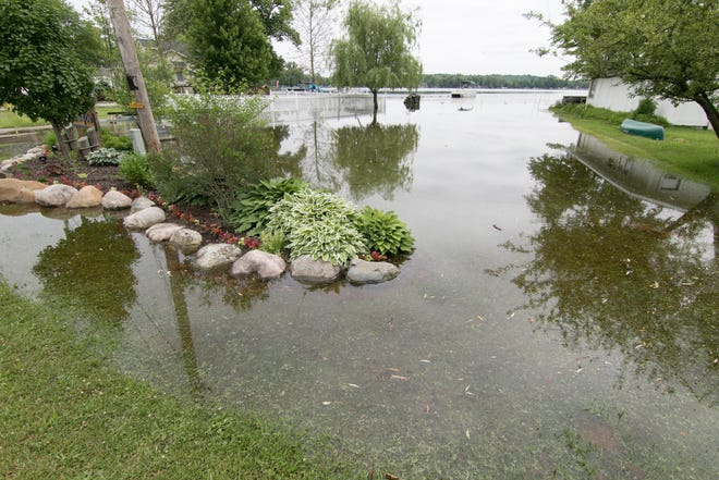 Flooding on Branch Rd. in the Northern Shores of Ore subdivision on Ore Lake has reached Branch Rd. in places Monday, June 17, 2019.