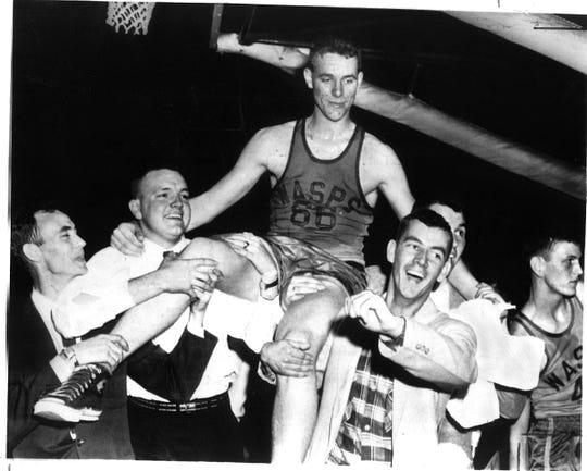 King Kelly Coleman was hoisted on the shoulders of fans after scoring 68 points in the third-place game of the 1956 state basketball tournament at Memorial Coliseum in Lexington. He was still mad because the crowd had booed him in an earlier game. He played for Wayland High School.