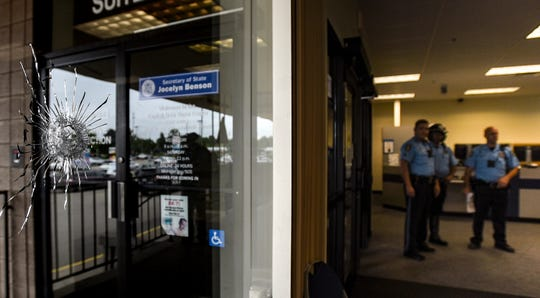 A bullet hole can be seen June 17 from inside the Lansing Secretary of State's office near the Frandor Shopping Center. No injuries were reported.