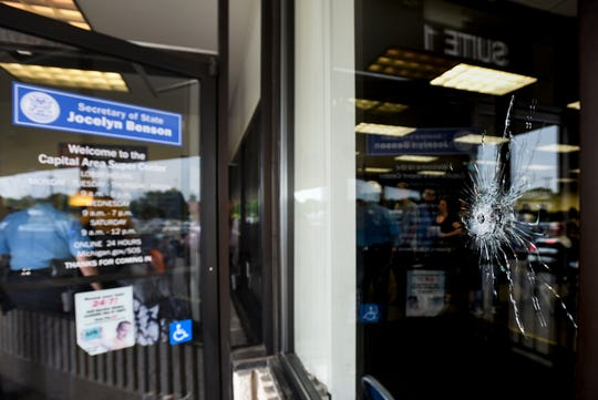 A bullet hole can be seen Monday morning, June 17, 2019, in the window near the entrance of the Secretary of State office near Frandor Shopping Center in Lansing.  No injuries were reported.  Police are investigating.