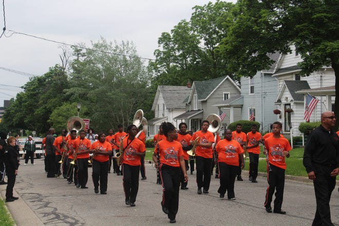 Benton Harbor High School Marching Band marches to the beat of their drum line on Saturday, June 15.