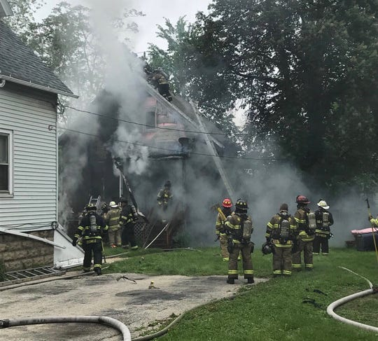 Firefighters subdue a house fire at 1308 S. 63rd St. in West Allis June 16. An occupant of the home had been trapped on the second floor and had to jump out of a window to safety.