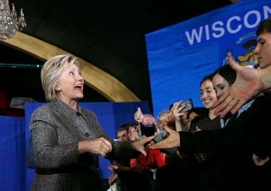 Former Secretary of State Hillary Clinton greets supporters on March 29, 2016, at the Riverside Ballroom in Green Bay. Clinton has not paid back the city for costs associated with the event.