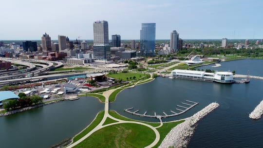 A drone provides an aerial view of the Milwaukee lakefront, including the Summerfest grounds, Lakeshore State Park and Discovery World, on June 3, 2019. While many of the lakefront festivals were again canceled this year, there are still many activities for families during the summer.