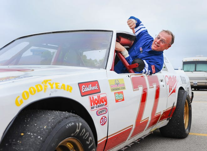 Mike Schliepp climbs out of his Bobby Allison replica car after the Upper Midwst Vintage Racing Series event Sunday at the Milwaukee MIle.