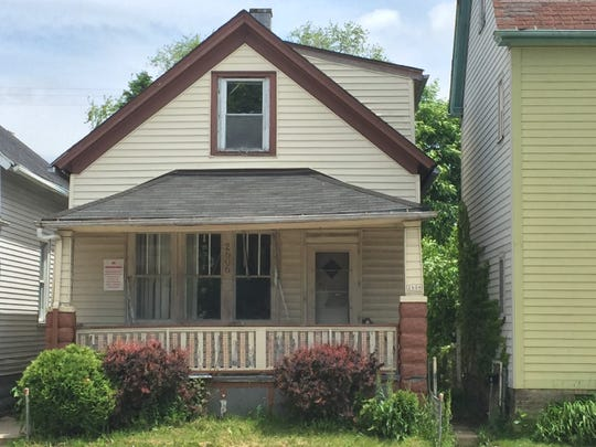 A city-owned house at 2606 N. Holton St. is the target of a new program designed to repair dilapidated homes while also training construction workers.