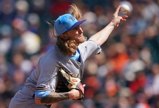 Josh Hader capped a strong day from the Brewers' bullpen by retiring all six Giants he faced -- three via the strikeout route -- in picking up his 17th save of the season.