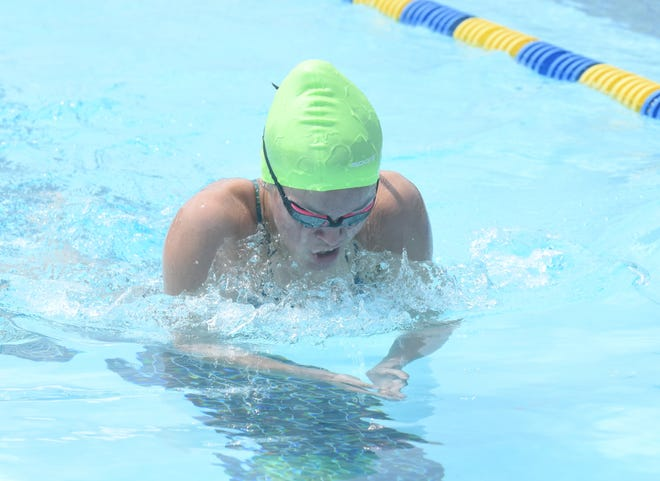 Mountain Home's Maddie Lynch competes in a breaststroke event Saturday at Cooper Park. Lynch set new girls' 18-and-under pool records Saturday in the 100 and 200 butterfly.