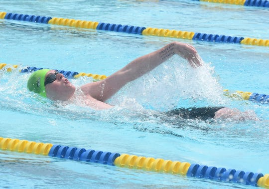 Mountain Home's Hudson Pace competes in the backstroke on Saturday.