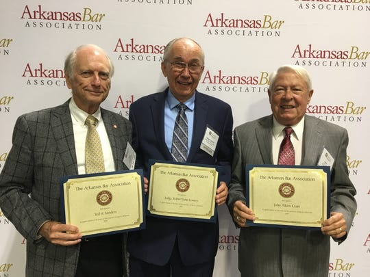 Three local attorneys were honored for 50 years of service at the annual Arkansas Bar Assocaiton meeting head June 12-14. Honored were: (from left) Ted Sanders, Judge Robert Lowery and John Crain.