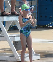 Annabelle Horn gives coaches the thumbs up before an event on Saturday.