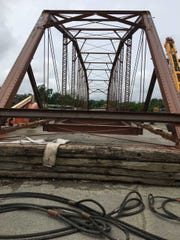 A historic bridge awaits a lift on Wednesday to the White River near East Jackson Street (Ind. 32).