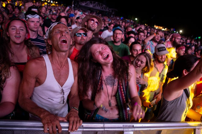 Fans react as Phish performs at the Bonnaroo Music and Arts Festival in Manchester, Tenn., Sunday, June 16, 2019.