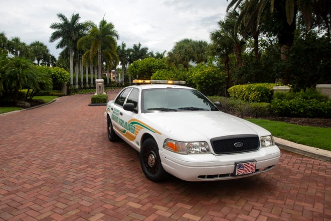 A Collier County Sheriff's Office Community Patrol Volunteer vehicle blocks off the entrance  to Southport Cove, Monday, June 17, 2019, in Bonita Springs