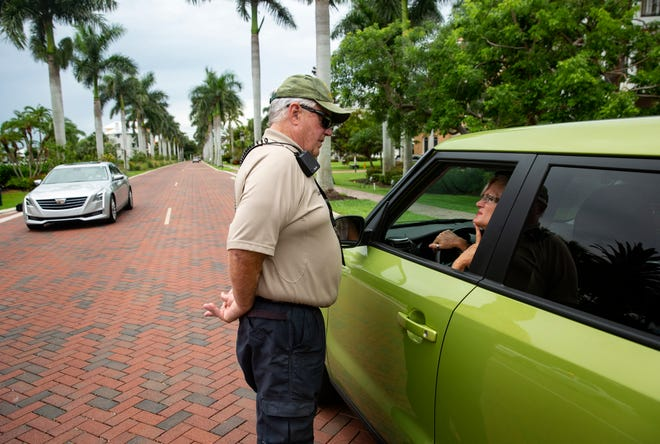 Collier County Sheriff's Office Community Patrol Volunteer William Leach informs residents that their street is closed off due to a gas leak, Monday, June 17, 2019, at the entrance of Southport Cove in Bonita Springs