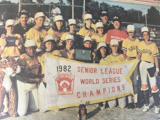 The 1982 Little League Senior Division national champion Greater Naples Braves squad gathers for a team photo after winning the title in Kalamazoo, Michigan. Kneeling from left to right are Delores Parker, Julie Zimmer, Caroline Seiffert, Marcia Frengel, Marisela Gutierrez and Nancy Raub. Standing from left to right are Margaret Pittman, coach Robert Iamurri, Heidi Mazeroski, Lisa Wissinger, Mary Beth Proffitt, Joy Swilley, Cheryl Murphy, manager Bill Longshore, assistant George Pittman, Marlo Mazeroski and Cindy Reynolds.