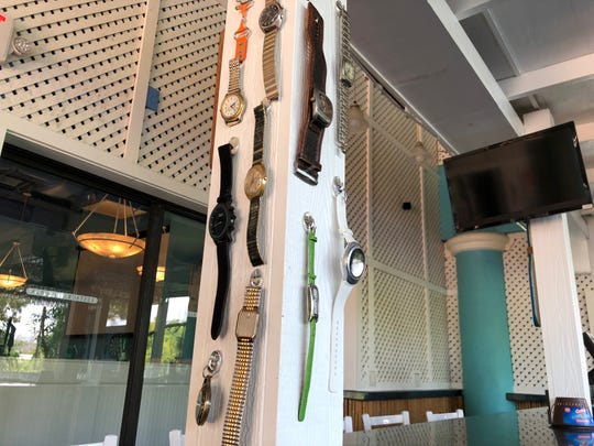 At The Broken Watch in North Naples, customers can bring in a broken watch to receive a free drink. Previous watches have been hung on the columns of the outdoor bar.