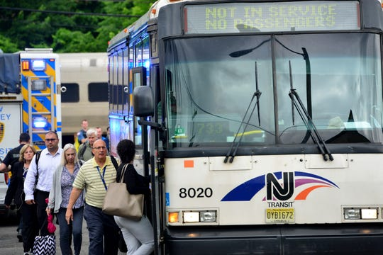 Passengers board an NJ Transit Bus to bring them to New York after person was struck and killed by a train on the Pascack Valley Line on Monday June 17, 2019 in Park Ridge, N.J.