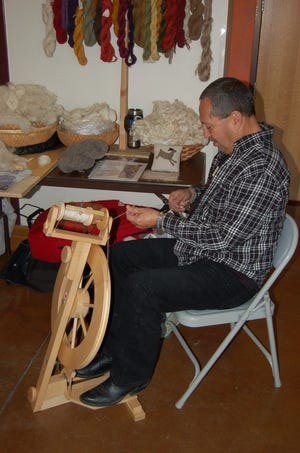 New Mexico Farm & Ranch Heritage Museum volunteer Ric Rao demonstrates wool spinning.