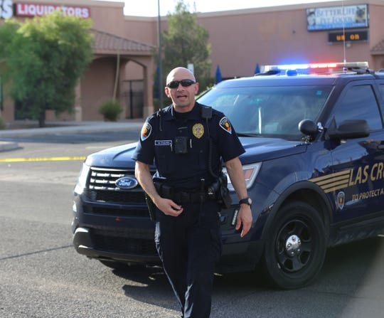 Las Cruces Police Officer Chavez, was busy turning away customers and employees at the shopping complex on Lohman Avenue, after an early morning shooting, Monday June 17, 2019.