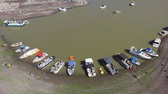 Boats arrive at Pirate Hill ready to jam out at The Butte Summer Concert Series at Elephant Butte Lake.