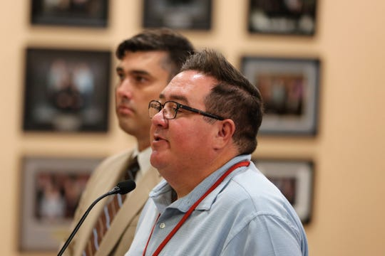 Gabe Jacquez, deputy superintendent of operations and leadership for Las Cruces Public Schools, speaks to the school board at its meeting on June 11, 2019. Next to him is Sean Barham, associate director of operations and security.